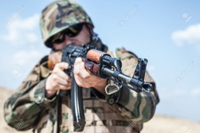 a-russian-soldier-in-bulletproof-vest-with-ak-47-rifle